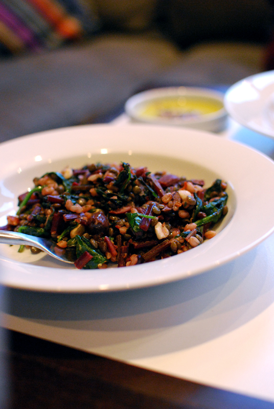 spicy wheatberries with beet greens, olives, and hazelnuts